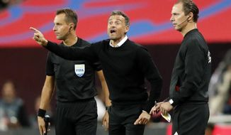 Spain head coach Luis Enrique, center, gestures during the UEFA Nations League soccer match between England and Spain at Wembley stadium in London, Saturday Sept. 8, 2018. (AP Photo/Frank Augstein)