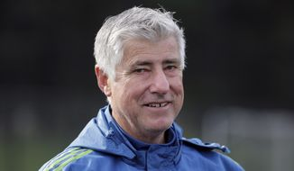 FILE - In this Oct. 27, 2015, file photo, then-Seattle Sounders head coach Sigi Schmid walks off the field following an MLS soccer training session, in Tukwila, Wash. Schmid, the winningest coach in Major League Soccer history who led the LA Galaxy to the first of five MLS Cup titles, has stepped down as coach of the Galaxy. The team said Schmid's resignation was effective immediately Monday, Sept. 10, 2018. Dominic Kinnear was named the interim head coach for the remainder of the season. (AP Photo/Ted S. Warren, File)