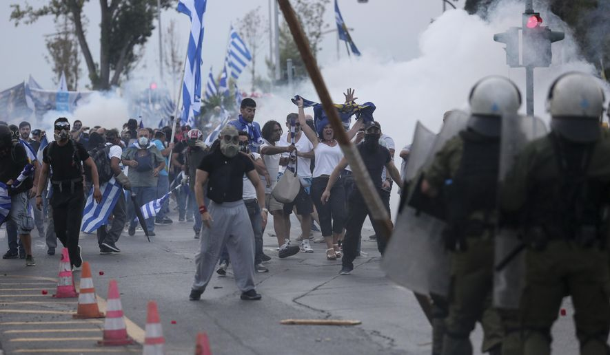 Protesters clash with riot police during a rally opposing Greece's name deal with neighbouring Macedonia at the northern Greek city of Thessaloniki, Saturday, Sept. 8, 2018. Greek police say about 6,000 protesters have tried to reach a venue where prime minister Alexis Tsipras is due to give a keynote address on the economy later Saturday and were pushed back with tear gas and stun grenades. (AP Photo/Dimitris Tosidis)