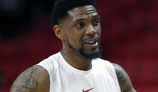 FILE - In this March 1, 2018, file photo, Miami Heat forward Udonis Haslem chats before the start of an NBA basketball game against the Los Angeles Lakers, in Miami. Udonis Haslem is barely given the chance to play anymore, and the Miami Heat wanted him back anyway. That's how much they value his presence. A person with knowledge of the negotiations said Haslem and the Heat have agreed on a one-year, $2.4 million contract that will keep him with his hometown team for a 16th season. The person spoke to The Associated Press Thursday on condition of anonymity because the contract has not been signed, though that last detail is now merely a formality. (AP Photo/Wilfredo Lee, File)