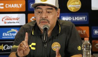Former soccer great Diego Maradona speaks at a press conference where he was presented as the new manager of the Dorados of Sinaloa, in Culiacan, Mexico, Monday, Sept. 10, 2018. Maradona, whose public battles with cocaine made him soccer's poster child for the perils of substance abuse, is setting up camp in Mexico's drug cartel heartland as the new coach of a second-tier team. (AP Photo/Marco Ugarte)