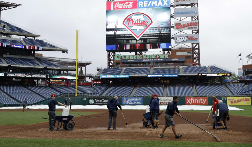 Grounds crew members work on the infield of Citizens Bank Park before a baseball game between the Philadelphia Phillies and Washington Nationals, Monday, Sept. 10, 2018, in Philadelphia. (AP Photo/Matt Slocum) **FILE**