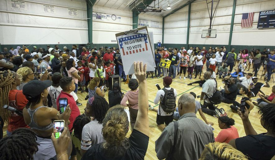 """""""Unity in Community"""" rally at Susan Park Playground which was organized as a """"peaceful protest"""" after widely-circulated memo by Kenner Ben Zahn banning Kenner's recreation booster clubs from purchasing Nike gear, Kenner, La. Monday, Sept. 10, 2018. (David Grunfeld /The Times-Picayune via AP)"""