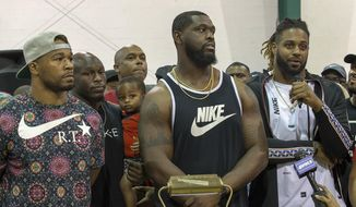 "From left, New Orleans Saints Craig Robertson, Chris Banjo (holding his son, Terron Armstead and Cam Jordan attend the ""Unity in Community"" rally at Susan Park Playground which was organized as a ""peaceful protest"" after widely-circulated memo by Kenner Ben Zahn banning Kenner's recreation booster clubs from purchasing Nike gear, Kenner, La. Monday, Sept. 10, 2018. (David Grunfeld /The Times-Picayune via AP)"