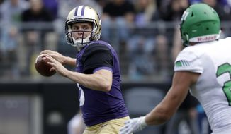 Washington quarterback Jake Browning drops back to pass against North Dakota in the second half of an NCAA college football game Saturday, Sept. 8, 2018, in Seattle. (AP Photo/Elaine Thompson)