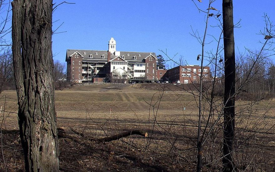 FILE - This Feb. 22, 2015, file photo shows buildings and property of Burlington College in Burlington, Vt. Prior to housing the college, the building was home to St. Joseph's Orphanage. Vermont Attorney General T.J. Donovan said Monday, Sept. 10, 2018, a task force is being launched to investigate abuse allegations at the orphanage, which closed in 1974. The Roman Catholic bishop of Burlington said the diocese will cooperate. (AP Photo/Wilson Ring, File)