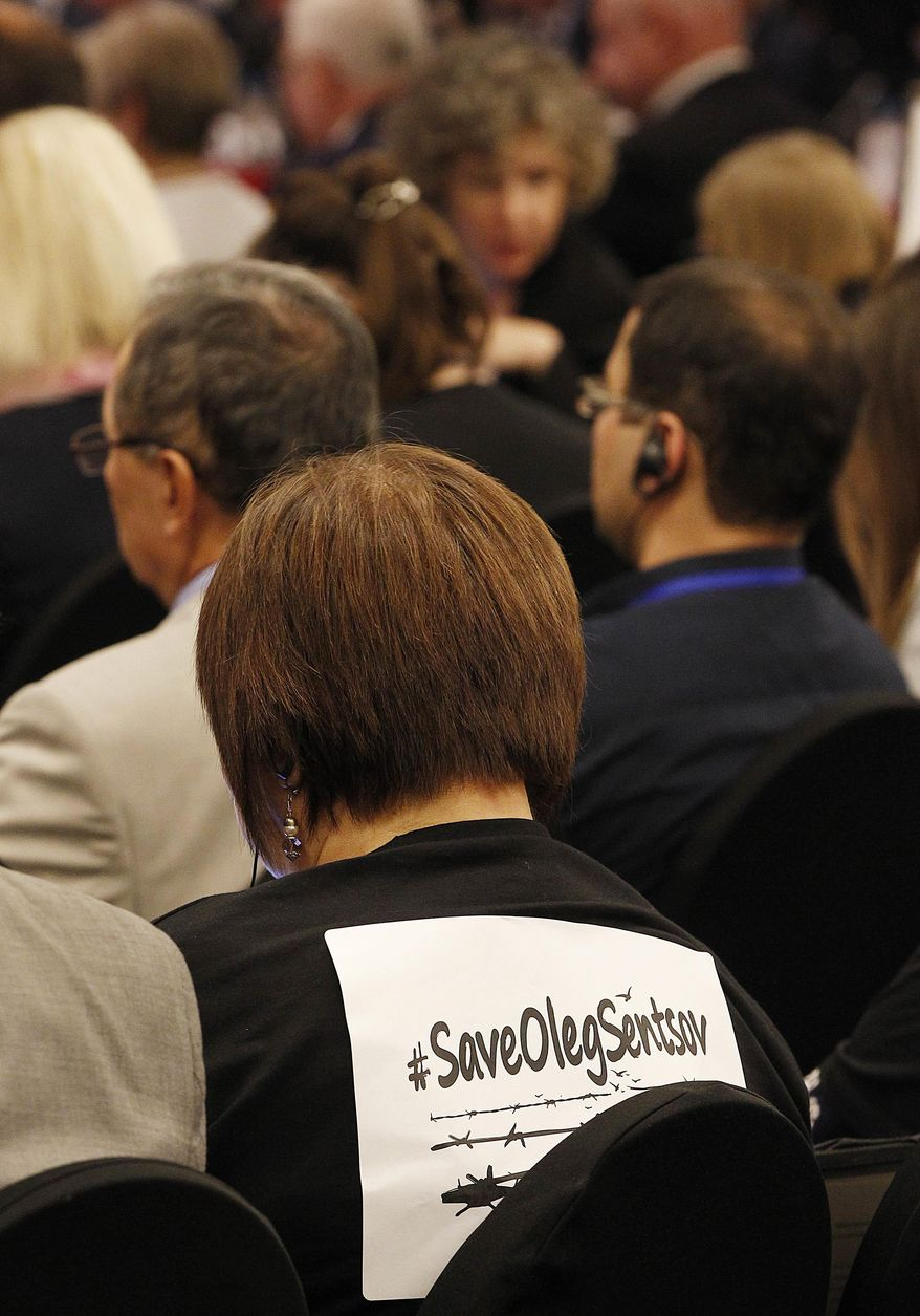 A human rights activist in a T-shirt declaring support for Oleg Sentsov, a Ukrainian filmmaker on hunger strike in a Russian prison, at the annual meeting of the Organization for Security and Cooperation in Europe in Warsaw, Poland, Monday, Sept. 10, 2018.(AP Photo/Czarek Sokolowski)