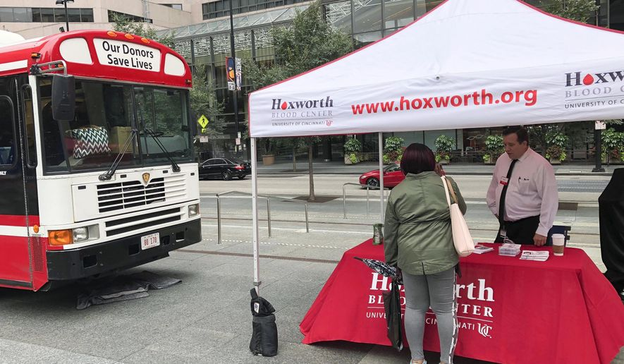 A blood donation station is set up at Fountain Square where a shooting took place on Sept. 6 that claimed the lives of three civilians, Monday, Sept. 10, 2018, in Cincinnati. The motives of the suspect Omar Enrique Santa Perez are still under investigation. (AP Photo/Dan Sewell)