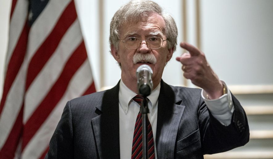 National Security Adviser John Bolton calls on a reporter during a news conference after speaking at a Federalist Society luncheon at the Mayflower Hotel, Monday, Sept. 10, 2018, in Washington. (AP Photo/Andrew Harnik)