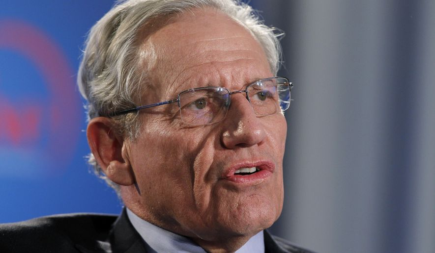 """FILE - This June 11, 2012 file photo shows former Washington Post reporter Bob Woodward speaking during an event to commemorate the 40th anniversary of Watergate in Washington. Woodward says top staffers in President Donald Trump's administration """"are not telling the truth"""" when they deny incendiary quotes about Trump attributed to them in his new book.  (AP Photo/Alex Brandon, file)"""
