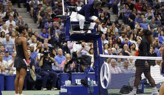 Serena Williams, right, talk with chair umpire Carlos Ramos as Naomi Osaka, of Japan, listens during the women's final of the U.S. Open tennis tournament, Saturday, Sept. 8, 2018, in New York. (AP Photo/Adam Hunger)