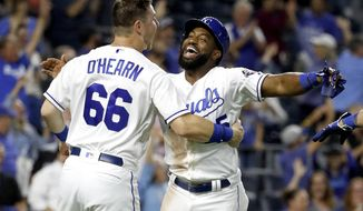 Kansas City Royals' Brian Goodwin celebrates with Ryan O'Hearn (66) after scoring the winning run on a sacrifice bunt hit by Alcides Escobar during the 10th inning of a baseball game against the Chicago White Sox Monday, Sept. 10, 2018, in Kansas City, Mo. The Royals won 4-3. (AP Photo/Charlie Riedel)