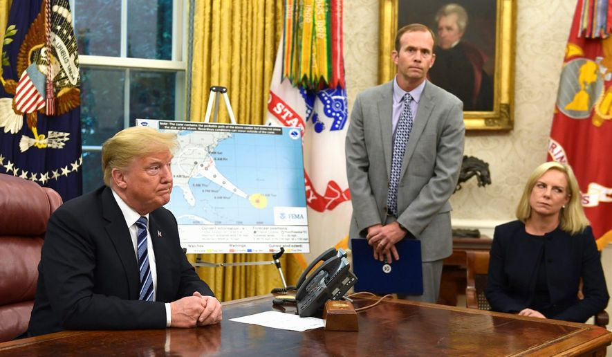 "Serious business: President Trump, FEMA Administrator Brock Long and Homeland Security Secretary Kirstjen Nielsen discuss incoming Hurricane Florence. The media is already labeling it ""Trump's Katrina."" (Associated Press)"