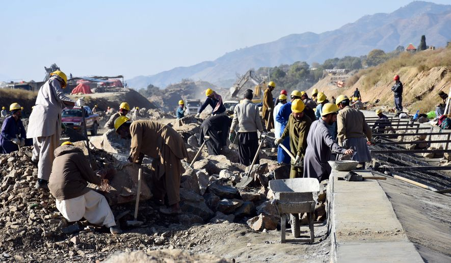 """In this Dec. 22, 2017, photo, work in progress at the site of Pakistan China Silk Road in Haripur, Pakistan. From Pakistan to Tanzania to Hungary, projects under Chinese President Xi Jinping's signature """"Belt and Road Initiative"""" are being canceled, renegotiated or delayed due to disputes about costs or complaints host countries get too little out of projects built by Chinese companies and financed by loans from Beijing that must be repaid. (AP Photo/Aqeel Ahmed)"""