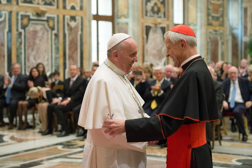 In this April 17, 2015, file photo, Pope Francis, left, talks with Papal Foundation Chairman Cardinal Donald Wuerl, Archbishop of Washington, D.C., during a meeting with members of the Papal Foundation at the Vatican. On Tuesday, Aug. 14, 2018, a Pennsylvania grand jury accused Cardinal Wuerl of helping to protect abusive priests when he was Pittsburgh's bishop. (L'Osservatore Romano/Pool Photo via AP)