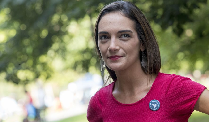 FILE - In this Wednesday, Aug. 15, 2018 file photo, Democratic New York state Senate candidate Julia Salazar smiles as she speaks to a supporter before a rally in McCarren Park in the Brooklyn borough of New York. Salazer said Tuesday, Sept. 11. 2018 that she was sexually assaulted five years ago by David Keyes , a spokesman for Israeli Prime Minister Benjamin Netanyahu, an accusation the man denies. (AP Photo/Mary Altaffer, File)
