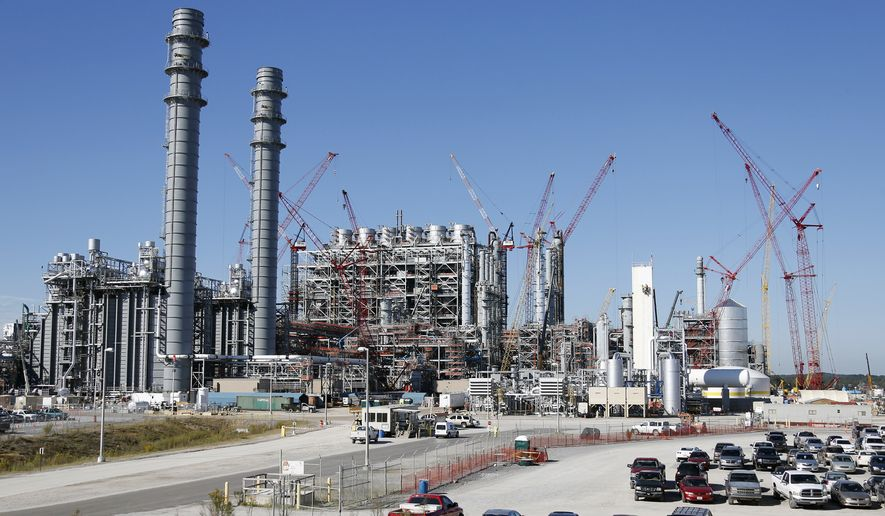 Mississippi Power's Kemper County energy facility in central Mississippi near DeKalb, Miss. The power plant is designed to use a soft form of coal called lignite in a gasification process to generate power. The plant, America's newest, most expensive coal-fired power plant is hailed as one of the cleanest on the planet, thanks to government-backed technology that removes carbon dioxide and keeps it out of the atmosphere. (AP Photo/Rogelio V. Solis)