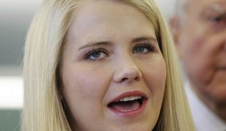 FILE - In this July 6, 2017, file photo, kidnapping victim Elizabeth Smart speaks to reporters during a tour of the state crime lab in Taylorsville, Utah. Wanda Barzee, a woman convicted of helping a former street preacher kidnap Elizabeth Smart as a teenager from her Salt Lake City bedroom in 2002 and hold her captive will be released from prison next week. The surprise move announced Tuesday, Sept. 11, 2018, comes after authorities determined they had miscalculated the time Barzee previously served in federal custody. (AP Photo/Rick Bowmer, File)