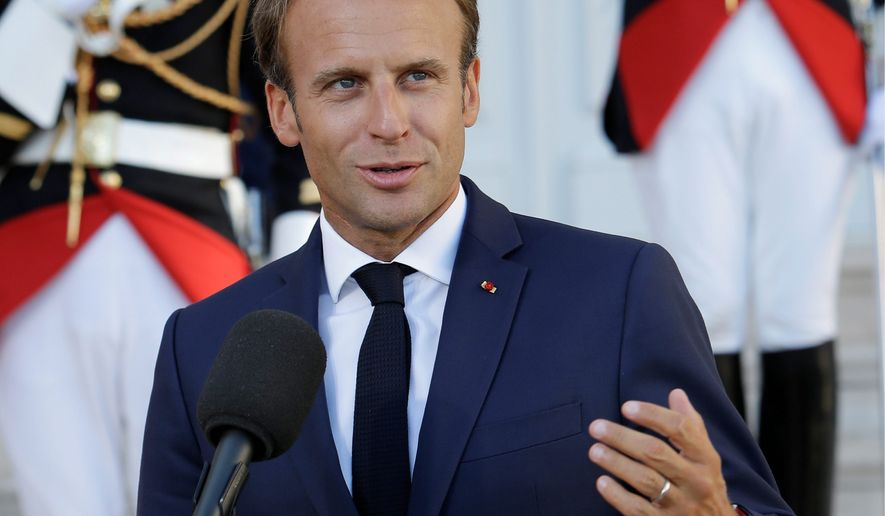 French President Emmanuel Macron gestures as he makes deceleration to the media as he meets German Chancellor Angela Merkel at the Pharo Palace in Marseille, southern France, Friday, Sept. 7, 2018. German Chancellor Angela Merkel is in Marseille for talks on European issues such as migration and eurozone reform. (AP Photo/Claude Paris)