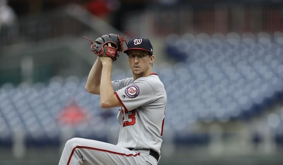 Washington Nationals' Erick Fedde in action during the first game of a baseball doubleheader against the Philadelphia Phillies, Tuesday, Sept. 11, 2018, in Philadelphia. (AP Photo/Matt Slocum) **FILE**