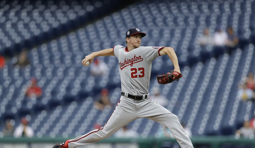 Washington Nationals' Erick Fedde in action during the first game of a baseball doubleheader against the Philadelphia Phillies, Tuesday, Sept. 11, 2018, in Philadelphia. (AP Photo/Matt Slocum)