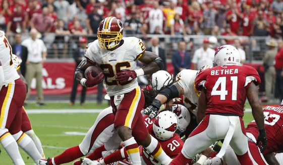 Washington Redskins running back Adrian Peterson (26) during an NFL football game against the Arizona Cardinals, Sunday, Sept. 9, 2018, in Glendale, Ariz. (AP Photo/Rick Scuteri) **FILE**