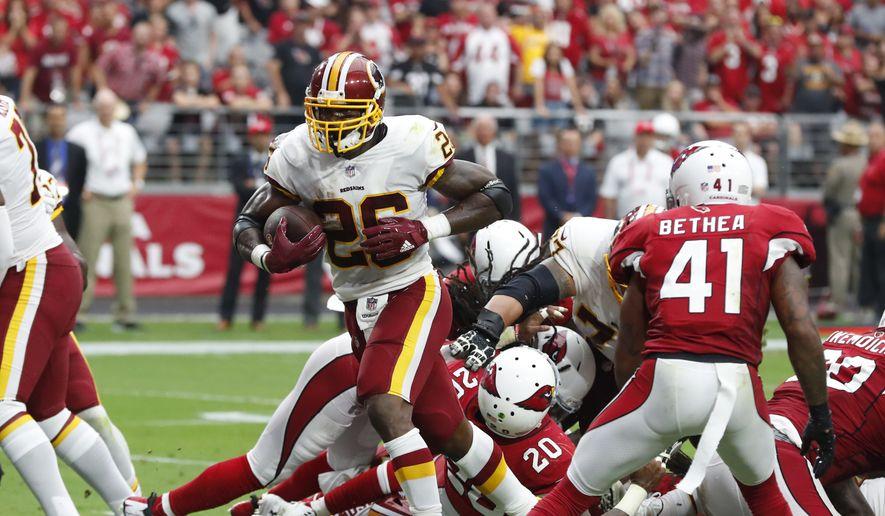 Washington Redskins running back Adrian Peterson (26) during an NFL football game against the Arizona Cardinals, Sunday, Sept. 9, 2018, in Glendale, Ariz. (AP Photo/Rick Scuteri) **FILE**