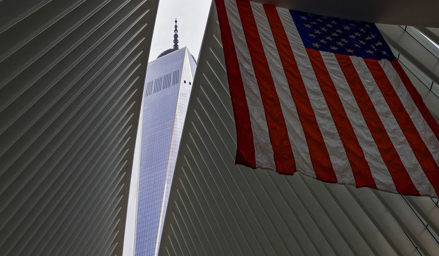 One World Trade Center appears through the open ceiling of the Oculus, part of the World Trade Center transportation hub in New York, Tuesday, Sept. 11, 2018, the anniversary of 9/11 terrorist attacks. The transit hall ceiling window was opened just before 10:28 a.m., marking the moment that the North Tower of the World Trade Center collapsed on September 11, 2001. (AP Photo/Craig Ruttle)