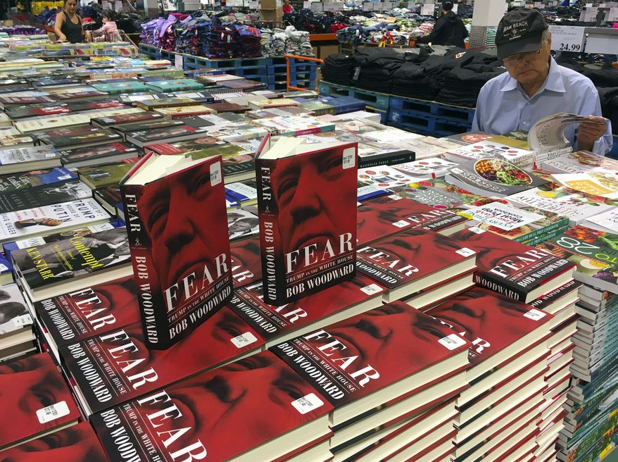 """Copies of Bob Woodward's """"Fear"""" are seen for sale at Costco, Wednesday, Sept. 11, 2018 in Arlington, Va. It's not clear whether President Donald Trump has much to fear from """"Fear"""" itself. But the book of that name has set off a yes-no war between author Bob Woodward and the president, using all the assets they can muster. (AP Photo/Pablo Martinez Monsivais)"""