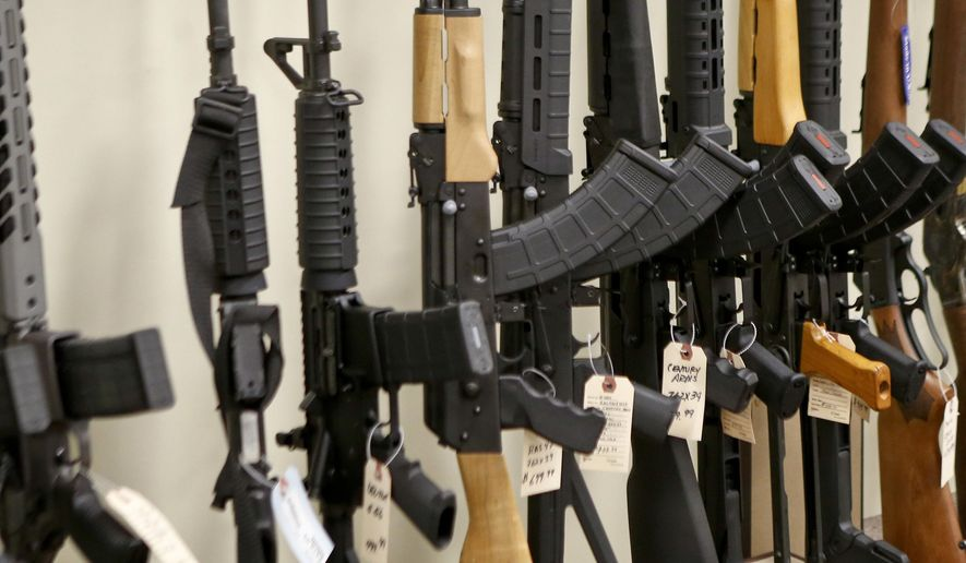 This March 1, 2018, file photo shows a display of various models of semi-automatic rifles at a store in Pennsylvania. (AP Photo/Keith Srakocic) ** FILE **