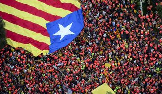 "ADDA BYLINE TITLE.- In this photo released by the ANC ( Assamblea Nacional de Catalunya ), pro-Independence demonstrators carry a giant ""estelada"" or independence flag during the Catalan National Day in Barcelona, Spain, Tuesday, Sept. 11, 2018. Hundreds of thousands Catalans have shouted in a collective roar along a main artery of Barcelona to demand independence from Spain. September 11, called ""Diada"", marks the fall of the Catalan capital to Spanish forces in 1714.(Roser Vilallonga/ ANC via AP)"