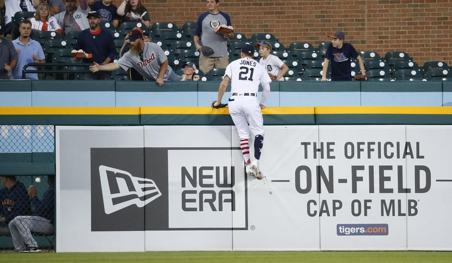 Detroit Tigers left fielder JaCoby Jones climbs the outfield wall but can't reach a Houston Astros' Tyler White two-run home run in the fourth inning of a baseball game against the Detroit Tigers in Detroit, Tuesday, Sept. 11, 2018. (AP Photo/Paul Sancya)
