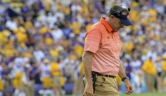 FILE - In this Oct. 14, 2017, file photo, Auburn head coach Gus Malzahn reacts as his team falls behind to LSU in the second half during an NCAA college football game, in Baton Rouge, La. No. 7 Auburn, it turns out, had more meaningful losses than the LSU game last season, but that one was certainly painful after blowing a 20-0 lead. (AP Photo/Matthew Hinton, File)