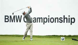 Keegan Bradley tees off on the 18th hole during the BMW Championship golf tournament at the Aronimink Golf Club, Monday, Sept. 10, 2018, in Newtown Square, Pa. Bradley held off Justin Rose in a sudden-death playoff to win the rain-plagued BMW Championship for his first PGA Tour victory in six years. (AP Photo/Chris Szagola)