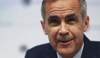 "FILE - In this Thursday, Aug. 2, 2018 file photo, Bank of England Governor, Mark Carney, speaks during a media conference to present the central bank's quarterly Inflation Report, in London. Carney has agreed to extend his period as governor by six months until January 2020 to help out with Britain's exit from the European Union, it was reported on Tuesday, Sept. 11, 2018. The announcement from the government and the bank was expected after Carney told lawmakers last week that he was ""willing"" to extend his tenure beyond his scheduled June 2019 departure. (Daniel Leal-Olivas/Pool via AP, File)"