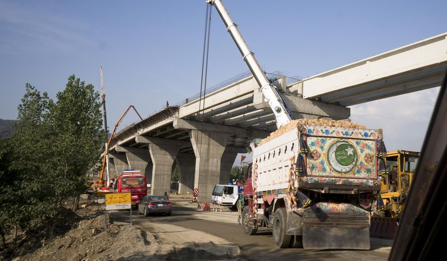 "FILE - This May 11, 2017, file photo shows construction work in progress at a new international trade route which part of a sprawling Chinese initiative to build a ""new Silk Road"" of ports, railways and roads to expand trade in a vast arc of countries across Asia, Africa and Europe, near Havalian in Pakistan.  A wave of Chinese-financed railways and other trade links in Africa and Asia that have prompted worries about debt and Beijing's ambitions is reducing politically dangerous inequality between regions within countries, a multinational group of researchers said Tuesday, Sept. 11, 2018. (AP Photo/B.K. Bangash, File)"