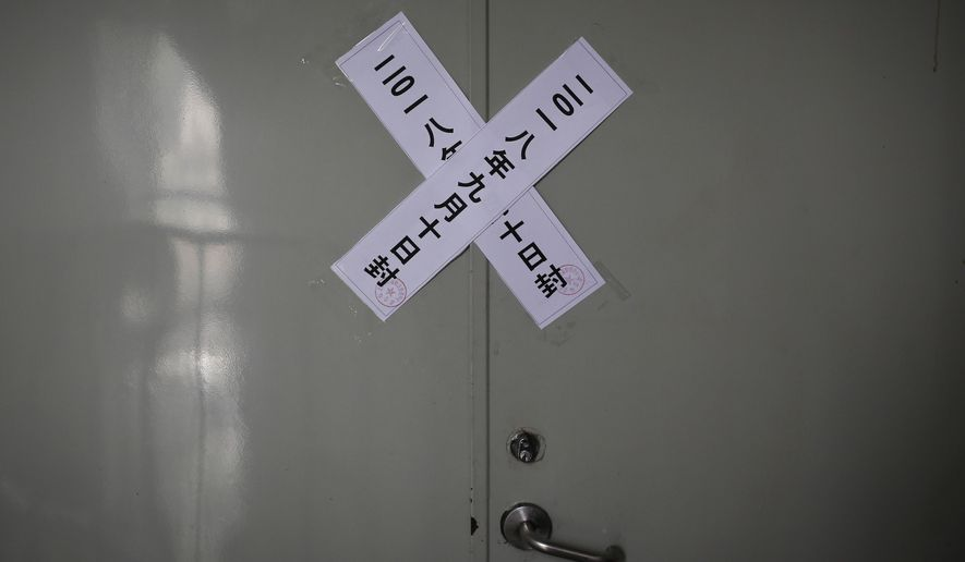 Official seal notices are sticked on a backdoor entrance of the Zion church after it was shutdown by authoritiwa in Beijing, Tuesday, Sept. 11, 2018. China is rolling out new rules on religious activity on the internet amid an ongoing crackdown on churches, mosques and other institutions by the officially atheist Communist Party. Anyone wishing to provide religious instruction or similar services online must apply by name and be judged morally fit and politically reliable, according to draft regulations posted online late Monday by the State Administration for Religious Affairs. (AP Photo/Andy Wong)