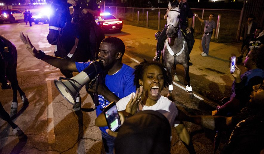 Dominique Alexander speaks to the protesters of the shooting of Botham Jean on Monday, Sept. 10, 2018 at the Jack Evans Police Headquarters in Dallas. Jean was shot Thursday by off-duty Dallas police officer Amber Guyger, who says she mistook his apartment for hers.  (Shaban Athuman /The Dallas Morning News via AP)