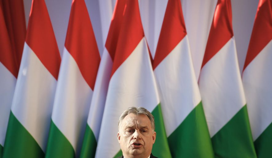 FILE - In this Friday, April 6, 2018 file photo Hungary's Prime Minister Viktor Orban speaks during the final electoral rally of his Fidesz party in Szekesfehervar, Hungary. The European Parliament is set to debate a move toward imposing political sanctions on Hungary for policies that opponents say are against democratic EU values and the rule of law. (AP Photo/Darko Vojinovic, file)