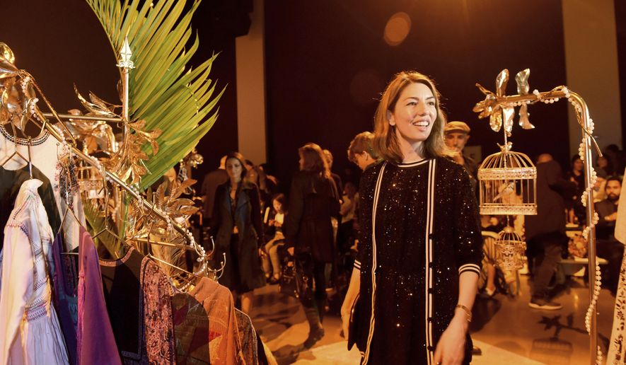 Sofia Coppola walks through a bazaar set up on the runway before the Anna Sui spring 2019 collection is shown at New York Fashion Week, Monday, Sept. 10, 2018. (AP Photo/Diane Bondareff)