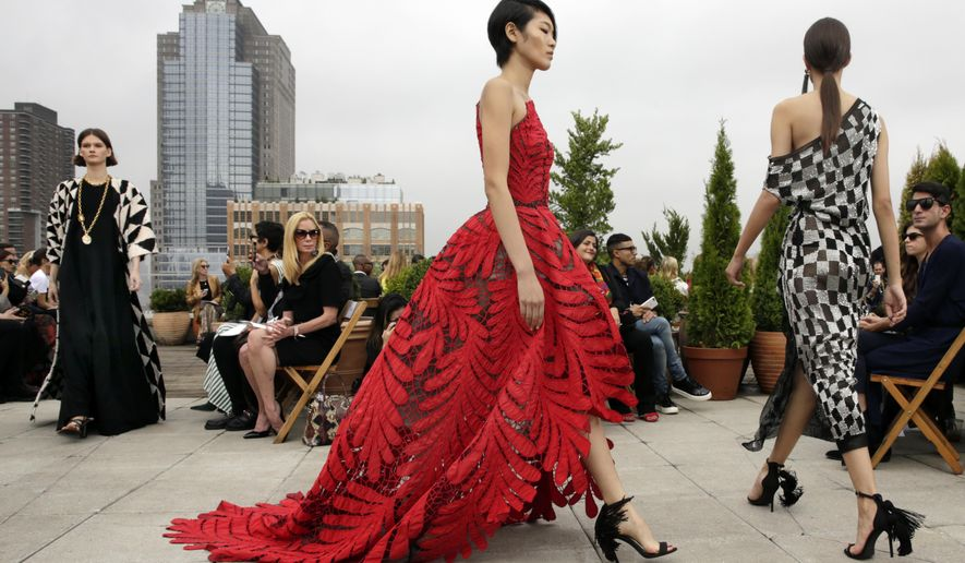 Models walk in the finale of the Oscar de la Renta spring 2019 collection during Fashion Week in New York, Tuesday, Sept. 11, 2018. (AP Photo/Richard Drew)