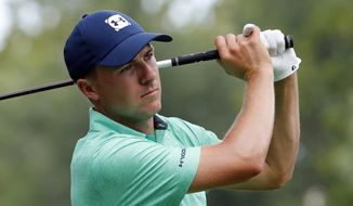 "FILE - In this Aug. 8, 2018 file photo Jordan Spieth watches his tee shot on the 15th hole during a practice round for the PGA Championship golf tournament at Bellerive Country Club in St. Louis. Spieth shed a little insight on his expectations at the start of 2016 when he said his goals start with winning and include ""being there"" with a chance in a couple of major championship. He only got part of that correct this season. Now he might look at not waiting until January to start the next season. (AP Photo/Jeff Roberson, file)"