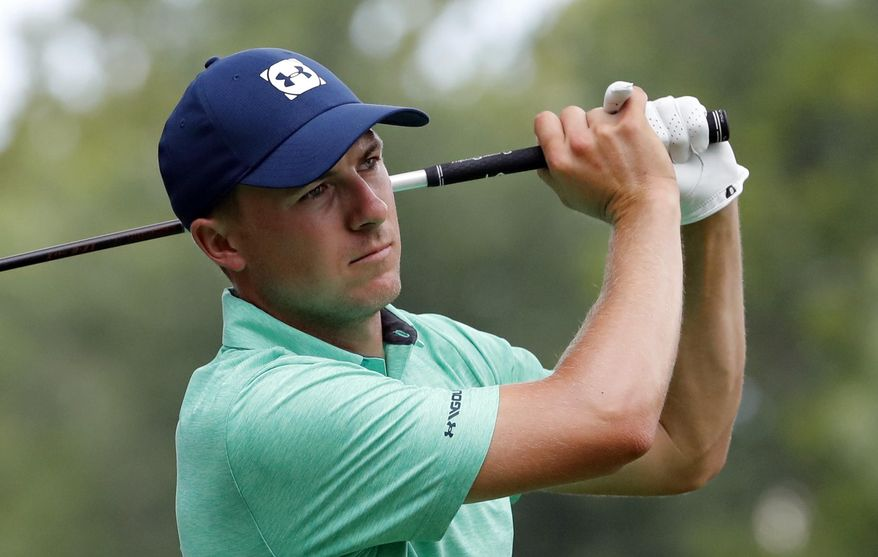"""FILE - In this Aug. 8, 2018 file photo Jordan Spieth watches his tee shot on the 15th hole during a practice round for the PGA Championship golf tournament at Bellerive Country Club in St. Louis. Spieth shed a little insight on his expectations at the start of 2016 when he said his goals start with winning and include """"being there"""" with a chance in a couple of major championship. He only got part of that correct this season. Now he might look at not waiting until January to start the next season. (AP Photo/Jeff Roberson, file)"""