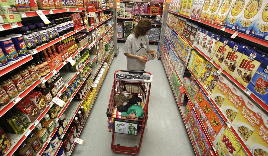 FILE - In this Dec. 14, 2010, file photo, Alicia Ortiz shops through the cereal aisle as her daughter Aaliyah Garcia catches a short nap in the shopping cart at a Family Dollar store in Waco, Texas. Don't be intimidated by the idea of a weekly big supermarket shop. Buying a lot in one fell swoop helps keep your kitchen organized and well-stocked all week. (AP Photo/Tony Gutierrez, File)