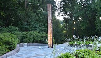 A rust-colored steel column recovered from the rubble of the World Trade Center on 9/11 has a new home at CIA Headquarters just outside the nation's capital, the federal agency announced Tuesday. (Image courtesy of CIA)