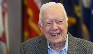 FILE - In this April 11, 2018 file photo, former President Jimmy Carter, 93, sits for an interview before a book signing in Atlanta. Carter is cautioning Democrats that their path to defeating President Donald Trump depends on independents and moderates. Carter says that U.S. policies on immigration, the environment and human rights will not improve while Trump is in office and that many independents are souring on the current president. (AP Photo/John Amis, File)
