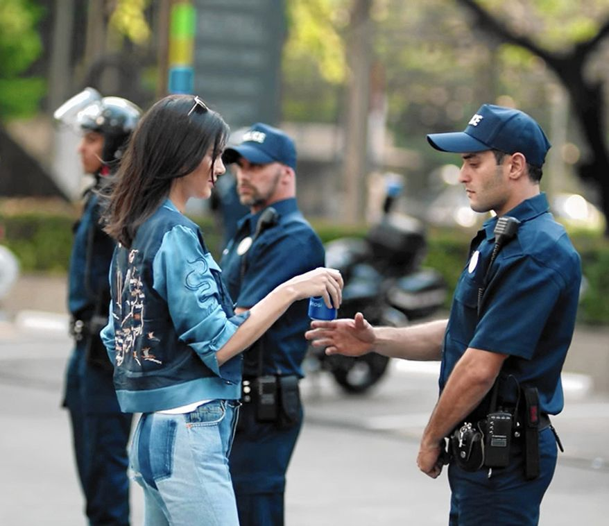 "Pepsi's ""Live For Now Moments"" starring Kendall Jenner. Pepsi's attempt combine political activism with the notoriously apolitical Jenner/Kardashian sisters set the internet ablaze, and the image showing Kendall Jenner sharing a Pepsi with a riot cop was widely considered taste-less."