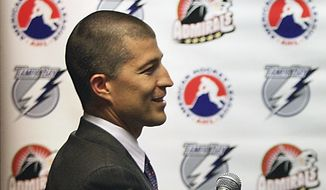 In this Aug. 10, 2010, file photo, then-Norfolk Admirals ice hockey team general manager Julien BriseBois is shown during a press conference in Norfolk, Va. A person with knowledge of the move says Steve Yzerman is stepping down as general manager of the Tampa Bay Lightning and will be replaced immediately by assistant Julien BriseBois. The person spoke to The Associated Press on condition of anonymity Tuesday, Sept. 11, 2018, because the team had not announced Yzerman's decision.(Hyunsoo Leo Kim/The Virginian-Pilot via AP, File)