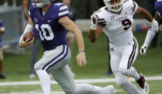 Kansas State quarterback Skylar Thompson (10) gets past Mississippi State defensive end Montez Sweat (9) as he runs the ball during the first half of an NCAA college football game Saturday, Sept. 8, 2018, in Manhattan, Kan. (AP Photo/Charlie Riedel)