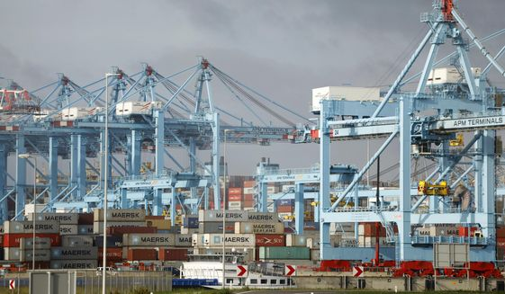 Containers are stacked in the harbor of Rotterdam, Netherlands, Tuesday, Sept. 11, 2018, during a press tour showing the implications of Brexit on the delivery of goods and supply chain. (AP Photo/Peter Dejong)